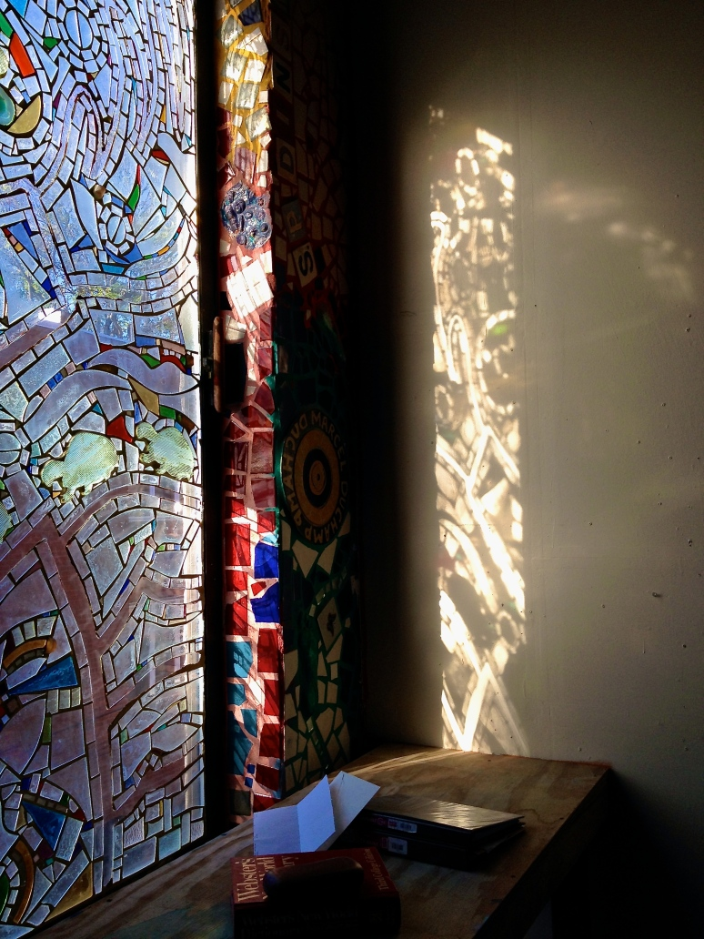 Light reflected on Isaiah Zagar's workshop wall.
